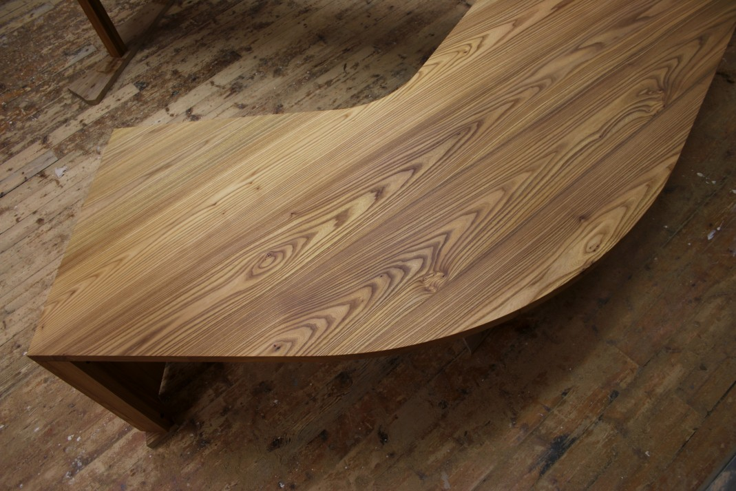 The desk top was fashioned from boards all cut from the same log.[/caption]  <a href=